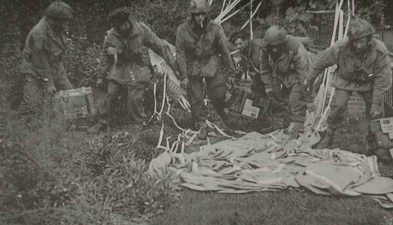 Army At War Arnhem Paratroops Remove Gear From Parachutes