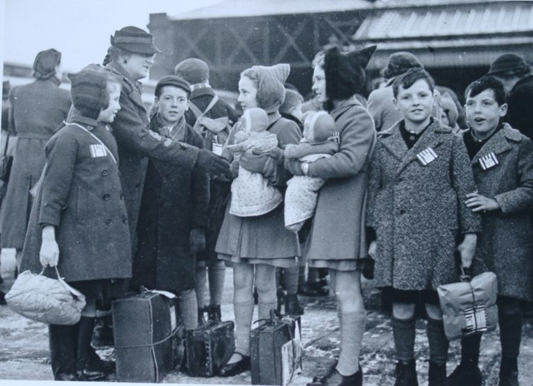 Evacuation In War Children With Labels And Dolls And Parcels Of Belongings