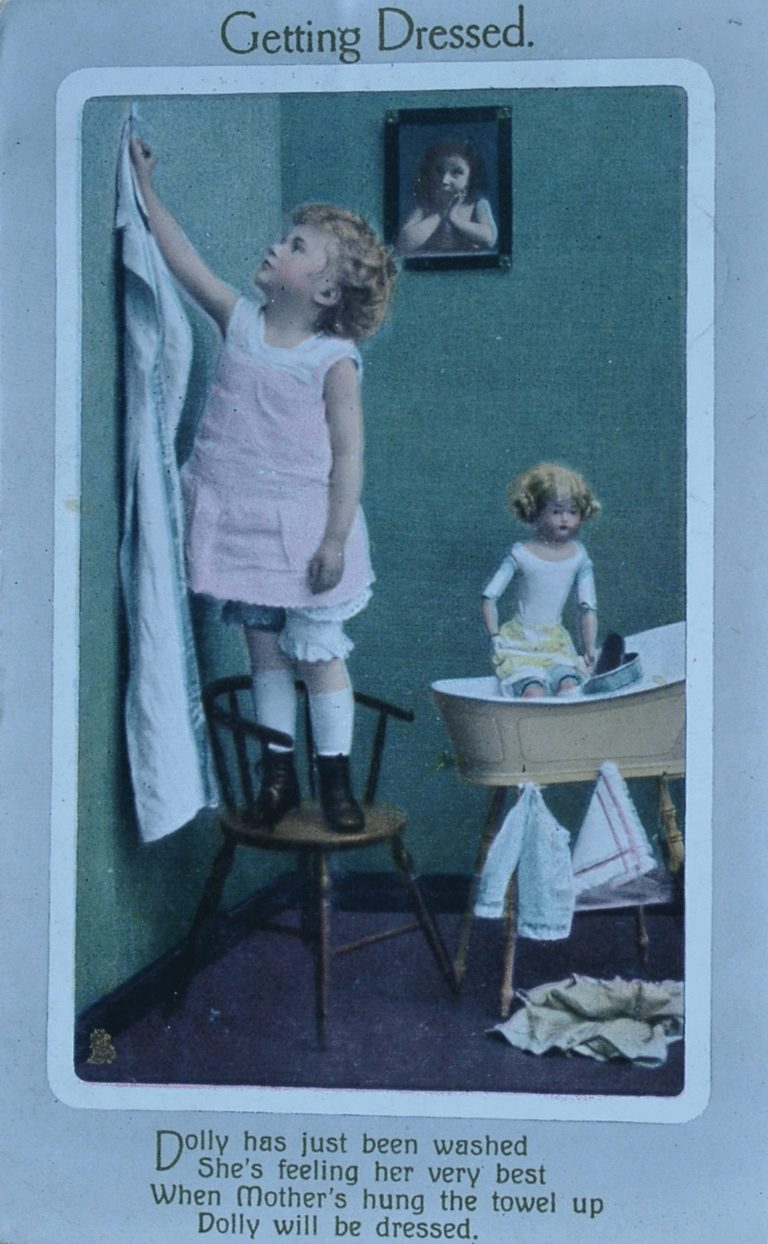 Postcard Infant Girl Dressing Dolly